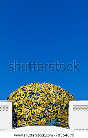 A golden cupola consisting of metal laurels on a museum in Vienna