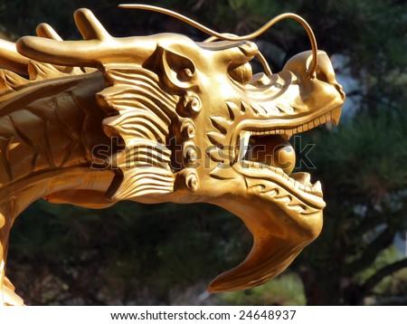 A golden dragon guarding a temple in downtown Cheongju, Korea. - stock photo