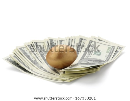 A golden egg on american dollars - stock photo