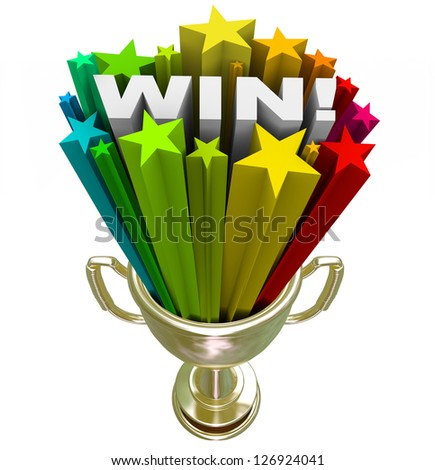 A golden first place trophy with the word Win and colored star fireworks blasting out of it, illustrating the excitement and drama of winning a contest or competition - stock photo