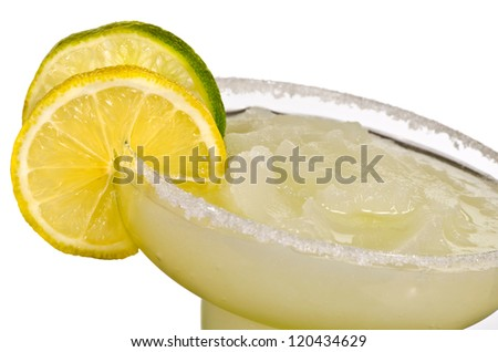 A Golden Margarita with a lemon and a Lime on the SIde Isolated - stock photo