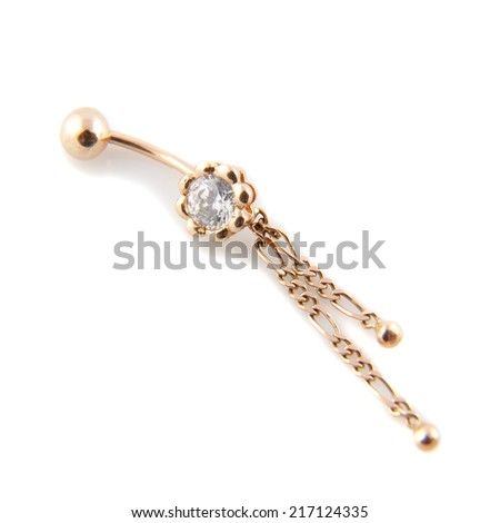 A golden piercing with a beautiful gem stone - stock photo