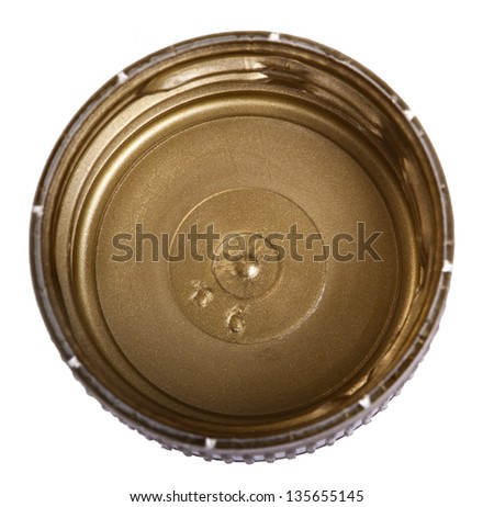 A golden plastic bottle cap shot from directly above, isolated on white background. Bottom side. - stock photo
