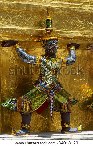 a golden thai angel statue inside grand palace in Bangkok