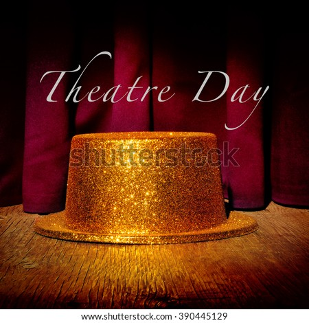 a golden top hat on a stage with an elegant act curtain in the background and the text theatre day - stock photo