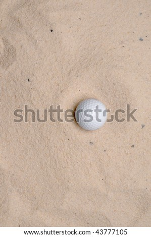 a golf ball in a sand trap - stock photo