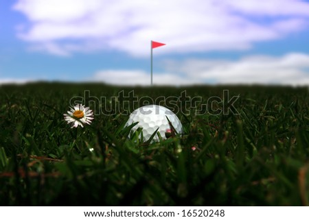 a golf ball in the rough with the flag in the distance - stock photo