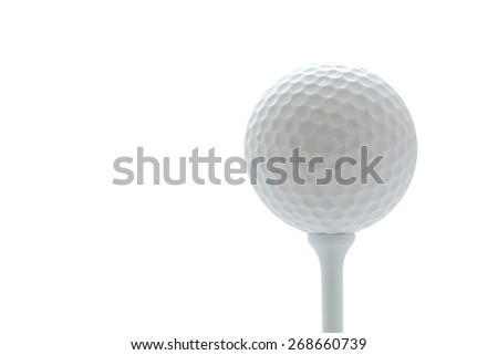A golf ball on a tee - stock photo
