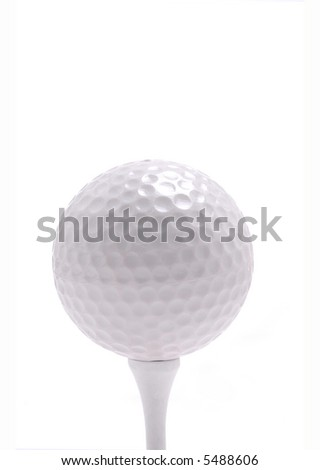 A golf ball rests on a tee.White Background. - stock photo