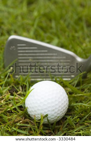 A golf ball waiting to be hit hard with a 3 iron