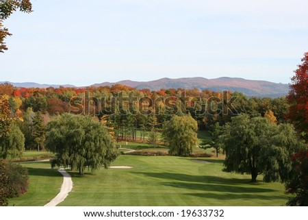 A golf course located in the Green mountains of Vermont ,in October at the peak of foliage season.