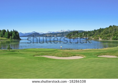 A golf filed by the lake