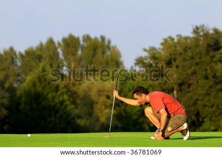 a golfer in concentration - stock photo