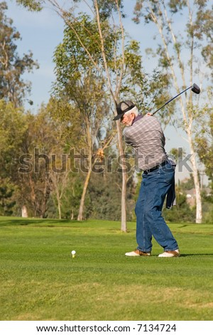 A golfer plays a round of golf at the country club resort - stock photo