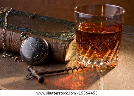 A good book and a glass of whisky - stock photo
