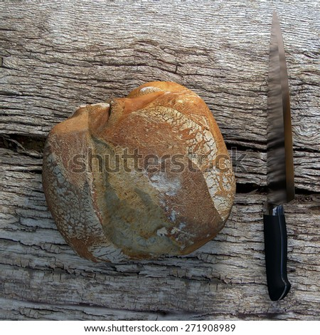A good bread campaign on a wooden and old table. We can smell, touch and eat this bread. - stock photo