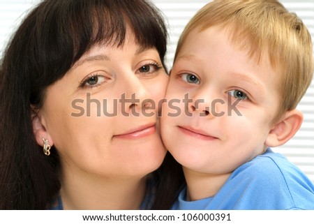 A good Caucasian mother and son a light background - stock photo