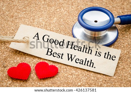 A good health is the best wealth card and stethoscope with red heart on wood table. Medical concept. - stock photo