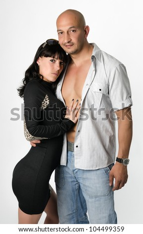 A good loking man and a woman with her hand on his bare chest - stock photo