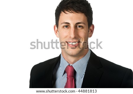 A good looking caucasian businessman smiling against a white background
