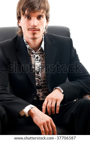 A good looking corporate manager confidently looking at the camera - stock photo