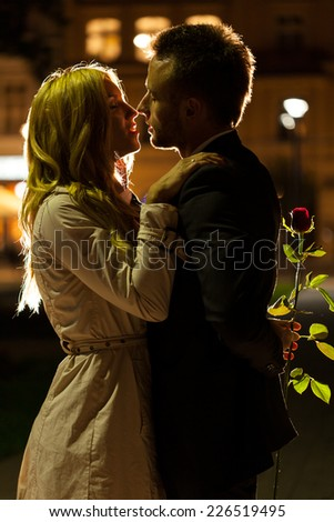 A good-looking couple about to kiss on a date night - stock photo