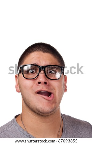 A goofy man wearing trendy nerd glasses isolated over white with a funny expression on his face. - stock photo