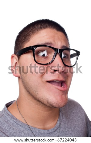 A goofy man wearing trendy nerd glasses isolated over white with a funny expression on his face.
