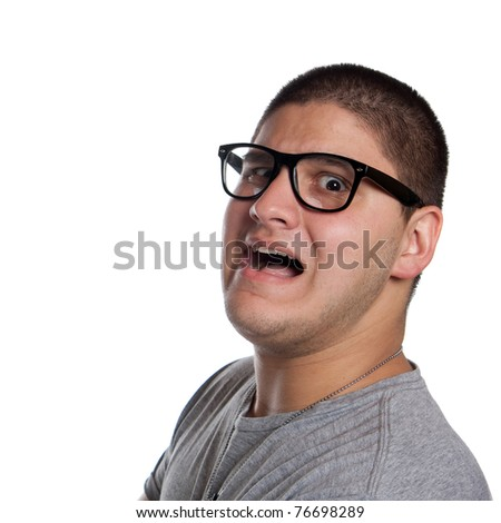 A goofy man wearing trendy nerd glasses isolated over white with a funny scared expression on his face.