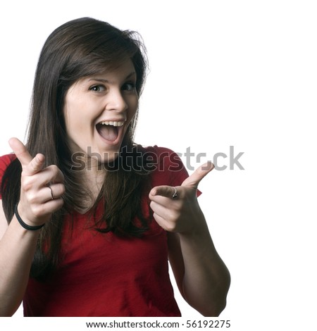 A goofy, smiling, young woman pointing at you with both hands.