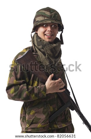 A goofy soldier with helmet, machine gun and funny eyes. - stock photo