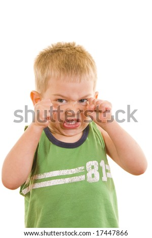 A gorgeous little cute three year old  boy doing an angry facial expression, isolated on white. - stock photo