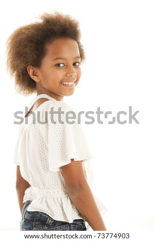 A gorgeous little 7yr old African girl in the studio.  White background. - stock photo