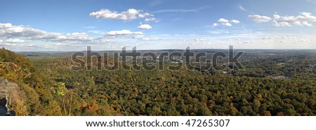 A gorgeous panoramic view of the fall foliage in Meriden Connecticut and Hubbard Park from Craig's Castle. - stock photo