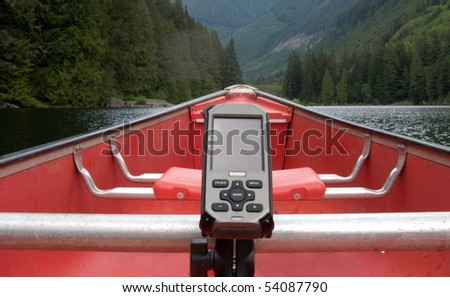 A GPS navigational unit is fastened into a canoe for navigation - stock photo