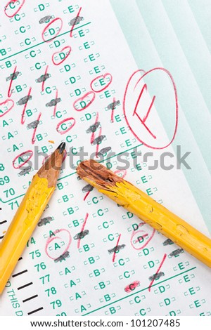 A graded test form with red scoring pencil marks indicates frustration and failure in the education system. - stock photo