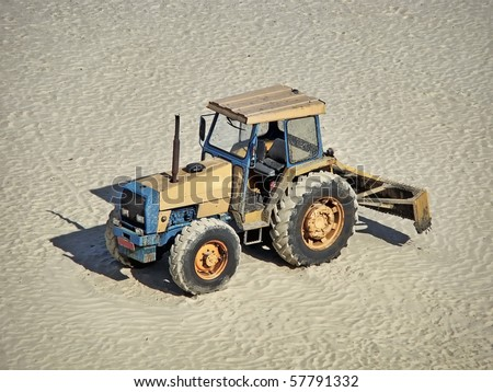 a grader truck parked on the sand - stock photo