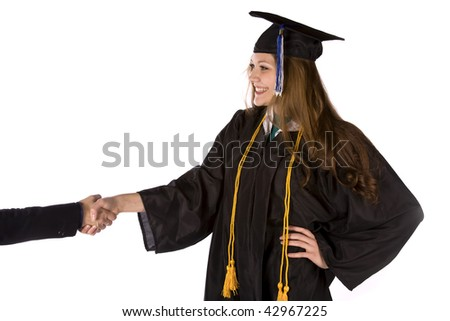 A graduate receiving a hand shake from a business person. - stock photo