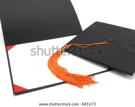 A graduate's cap with tassel, and an empty diploma frame - stock photo