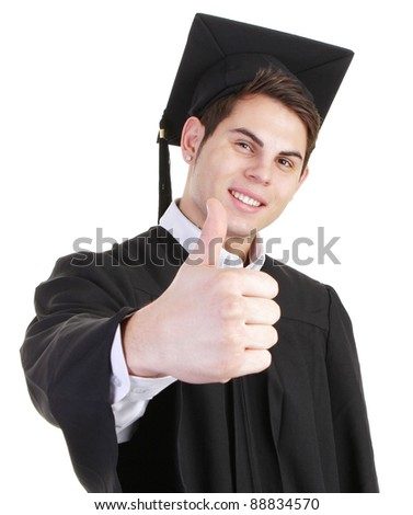 A graduate with a thumbs up sign - stock photo