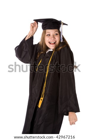 A graduate with an excited expression on her face with fist raised in the air. - stock photo