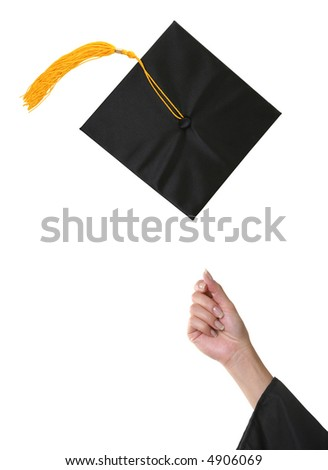A graduation cap after being thrown into the air - stock photo