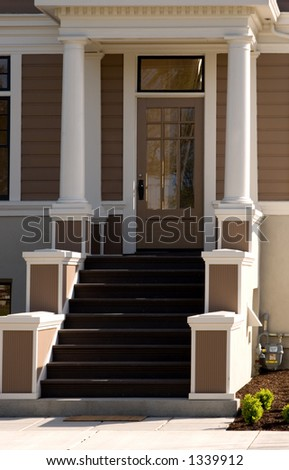 A grand entrance to a refurbished craftsman style home. - stock photo