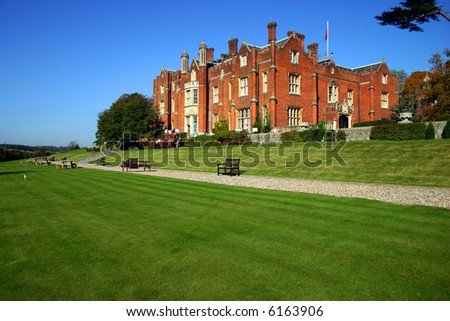 A grand stately home in southern England pictured on a summers day - stock photo