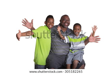 A grandfather having fun with his grandsons - stock photo