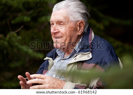A grandfather telling a story in the forest - stock photo