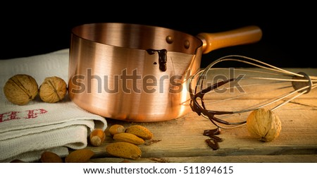 A grandma's kitchen,with chocolate,copper pot,walnut,chocolate,linen tablecloth.