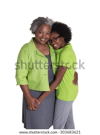 A grandmother and her granddaughter isolated on white - stock photo