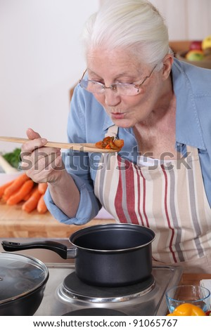 A grandmother cooking. - stock photo