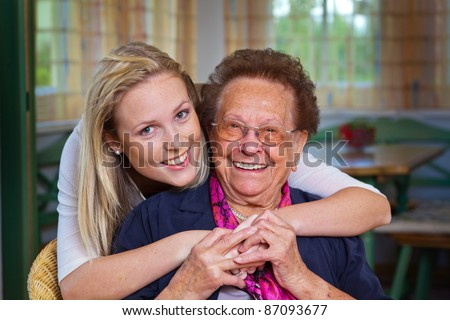 a grandson to visit his grandmother. fun and pleasure in the embrace. - stock photo